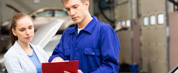 Car Mechanic Explaining Auto Repair Estimates